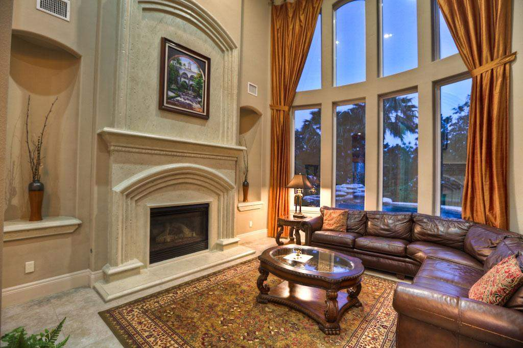 Grand Open Living Room Two Story Window Wall Looking Out