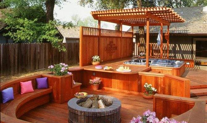 Large Hot Tub Deck Extends Over Fire Pit Area