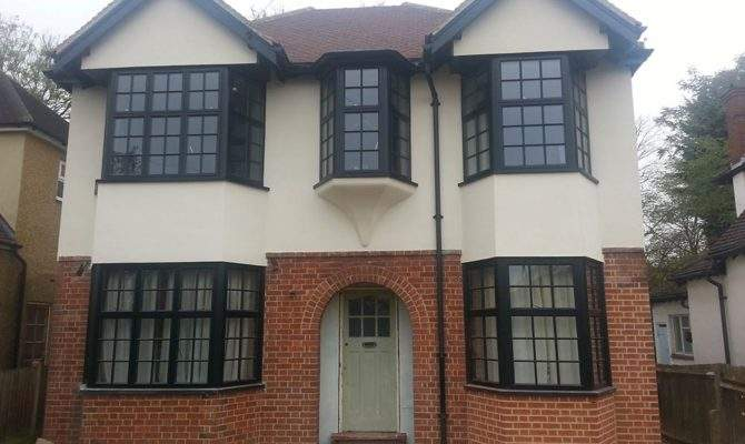 New Black Putty Line Windows Replacing Old Wooden Bay
