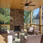 Screened Porch Natural Stone Fireplace Traditional