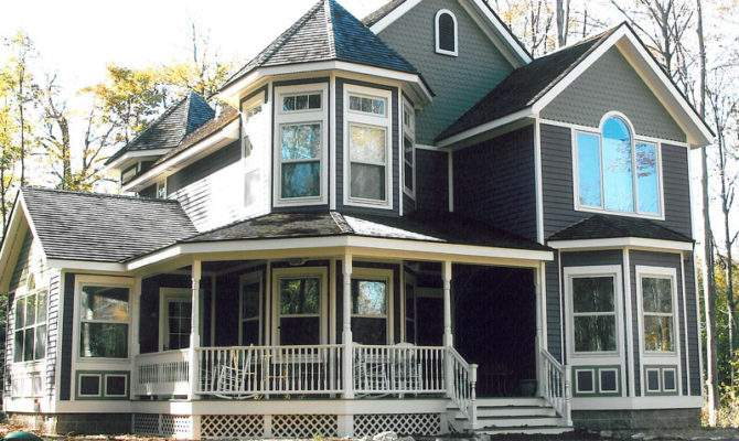 Two Story Victorian Home Covered Porch Turret Roof